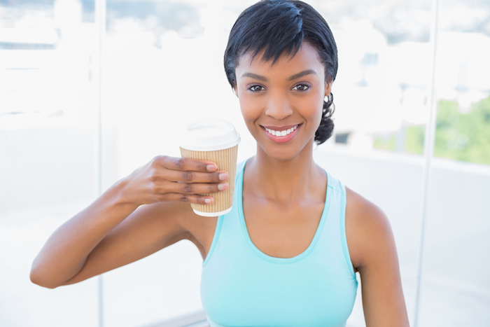 Woman drinking healthy coffee and exercising